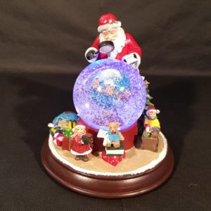 Santa planning his trip Snow Globe