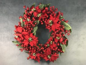 Wreath with red pointsettia and magnolia Berries